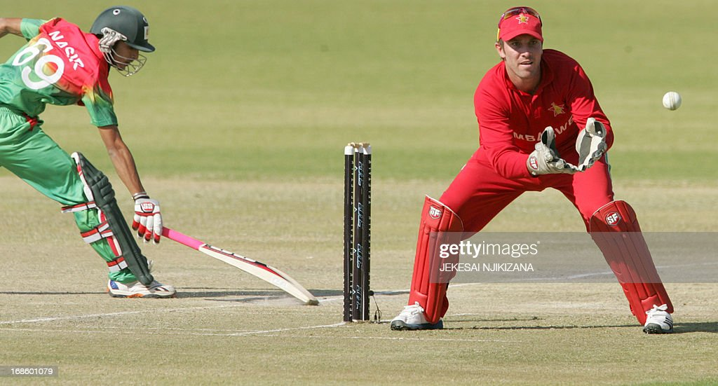 Zimbabwe's captain Brendan Taylor attempts a run out of Bangladesh batsman Nasir Hossain during the second and final Twenty20 international cricket series between Zimbabwe and Bangladesh on May 12, 2013 at the Queens Sports Club in Bulawayo. AFP PHOTO / Jekesai Njikizana