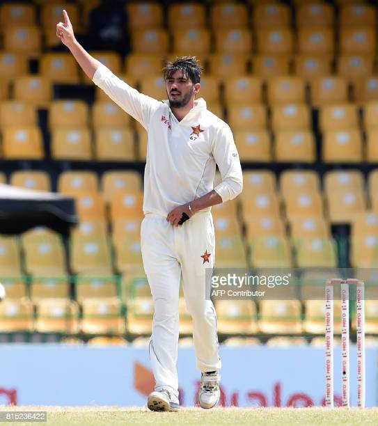 Zimbabwe's captain Graeme Cremer celebrates after he dismissed Sri Lankan cricketer Asela Gunaratne during the Third day of the only oneoff Test...