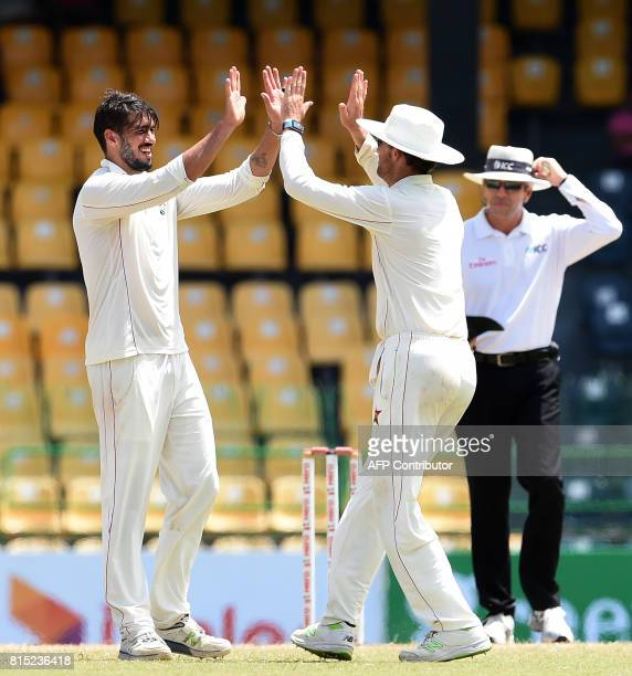 Zimbabwe's captain Graeme Cremer celebrates with his teammates after he dismissed Sri Lankan cricketer Asela Gunaratne during the Third day of the...