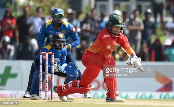 Zimbabwe's Craig Ervine plays a shot next to Sri Lanka's wicketkeeper Niroshan Dickwella during the first oneday international cricket match between...