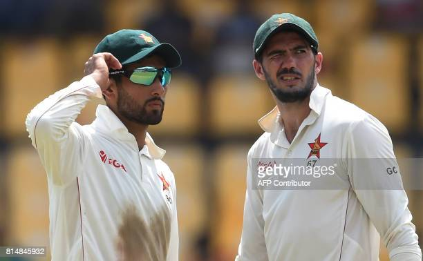 Zimbabwe's cricket captain Graeme Cremer and Sikandar Raza look on during the second day of the only oneoff Test match between Sri Lanka and Zimbabwe...