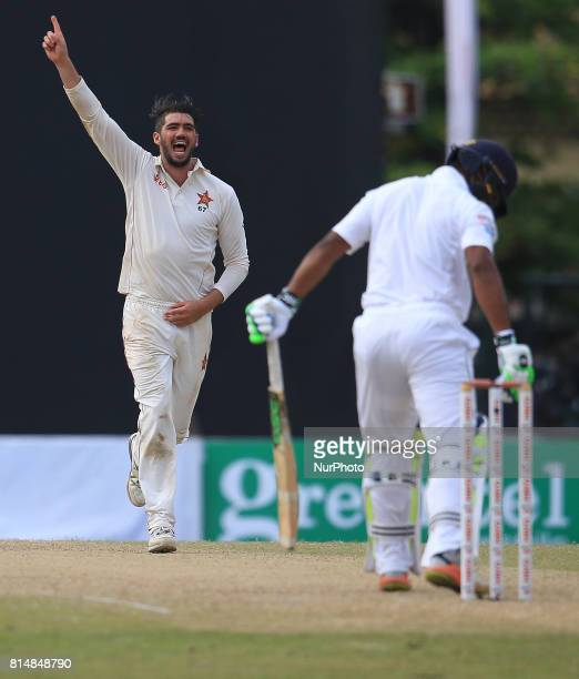 Zimbabwe's cricket captain Graeme Cremer celebrates after taking a wicket during the 2nd day's play of the only test cricket match between Sri Lanka...