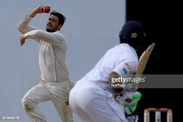 Zimbabwe's cricket captain Graeme Cremer delivers a ball during the 2nd day's play of the only test cricket match between Sri Lanka and Zimbabwe in...
