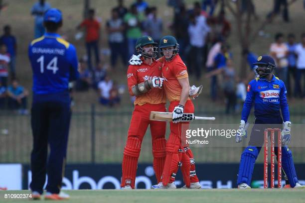 Zimbabwe's cricketer Craig Ervine and teammate Peter Moor celebrate after victory in the fourth oneday international cricket match between Sri Lanka...