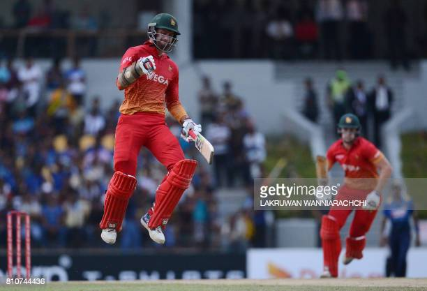 Zimbabwe's cricketer Craig Ervine celebrates after victory in the fourth oneday international cricket match between Sri Lanka and Zimbabwe at the...
