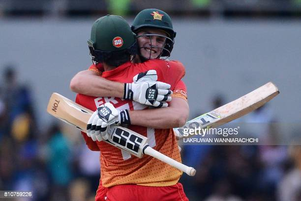 Zimbabwe's cricketer Craig Ervine celebrates with his teammate Peter Moor after victory in the fourth oneday international cricket match between Sri...