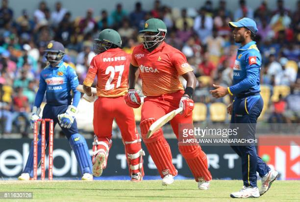 Zimbabwe's cricketer Hamilton Masakadza and teammate Solomon Mire run between wickets during the fifth oneday international cricket match between Sri...