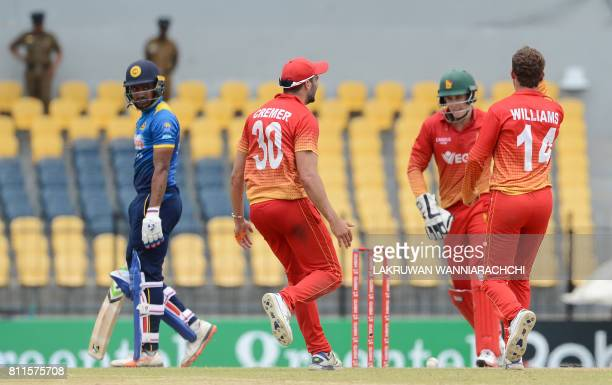 Zimbabwe's cricketer Sean Williams celebrates with his teammates after he dismissed Sri Lankan cricketer Danushka Gunathilaka during the fifth oneday...