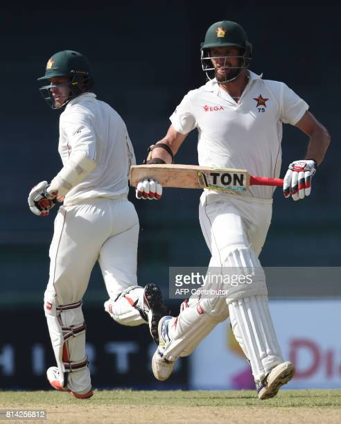 Zimbabwe's cricketers Craig Ervine and Malcolm Waller run between the wickets during the first day of the only oneoff Test match between Sri Lanka...
