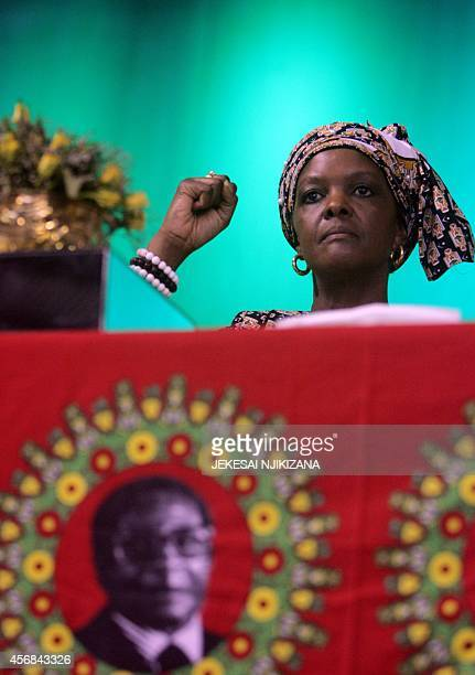 Zimbabwe's first lady Grace Mugabe raises her fist during a campaign meeting at the City Sports Center in Harare October 8 2014 Mugabe who was...