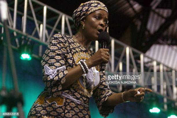 Zimbabwe's first lady Grace Mugabe speaks during a campaign meeting at the City Sports Center in Harare October 8 2014 Mugabe who was endorsed to...