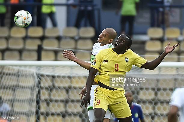 Zimbabwe's forward Nyasha Mushweki heads the ball with Algeria's midfielder Adlene Guedioura during the 2017 Africa Cup of Nations group B football...