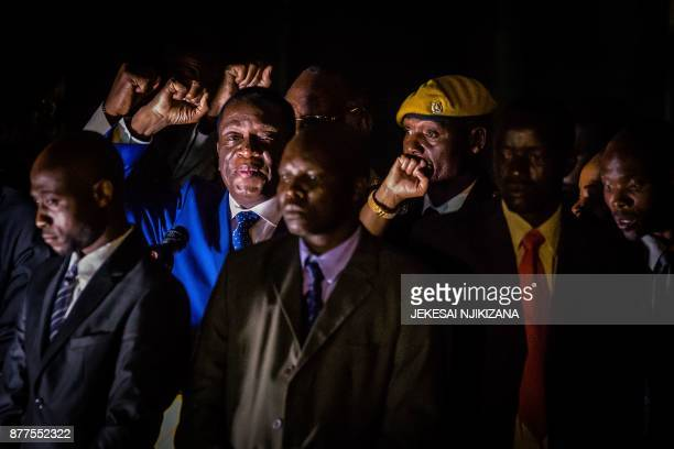 TOPSHOT Zimbabwe's incoming President Emmerson Mnangagwa gestures as he speaks to supporters at Zimbabwe's ruling ZanuPF party headquarters in Harare...