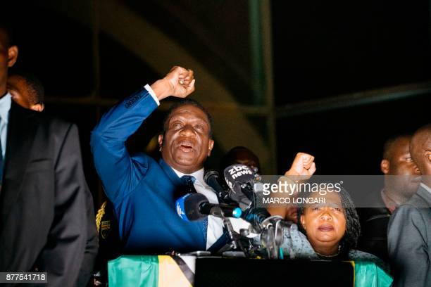 TOPSHOT Zimbabwe's incoming president Emmerson Mnangagwa speaks to supporters flanked by his wife Auxilia at Zimbabwe's ruling ZanuPF party...