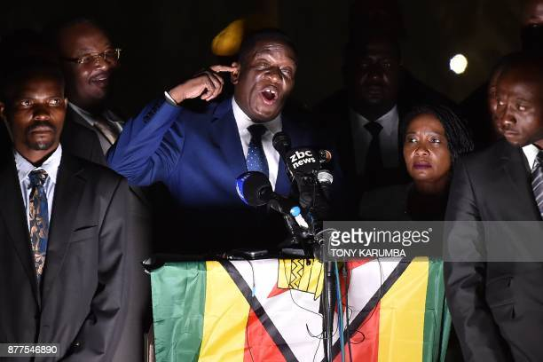 TOPSHOT Zimbabwe's incoming president Emmerson Mnangagwa speaks to supporters flanked by his wife Auxilia surrounded by their bodyguards at...