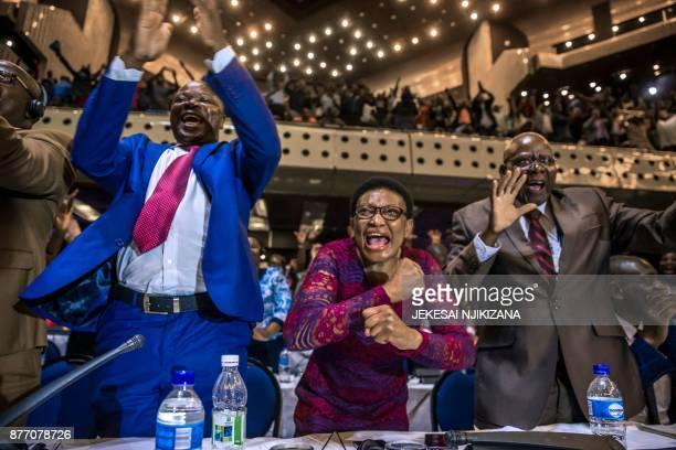 TOPSHOT Zimbabwe's members of parliament celebrate after Mugabe's resignation on November 21 2017 in Harare Robert Mugabe resigned as president of...
