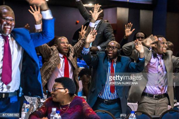 Zimbabwe's members of parliament celebrate after Mugabe's resignation on November 21 2017 in Harare Robert Mugabe resigned as president of Zimbabwe...