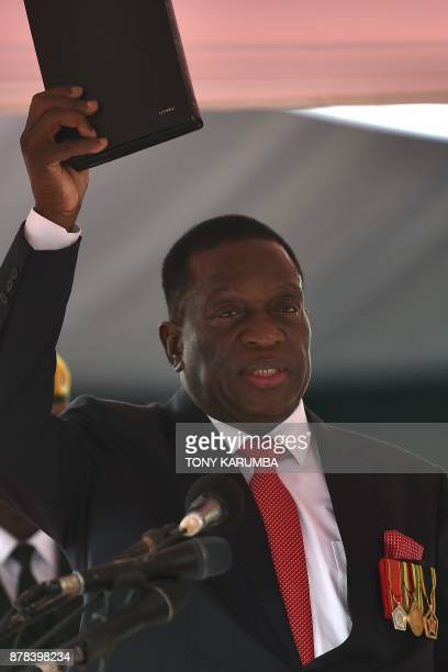 Zimbabwe's new interim President Emmerson Mnangagwa takes the oath of office before Chief judge of the Supreme Court as he is officially swornin...