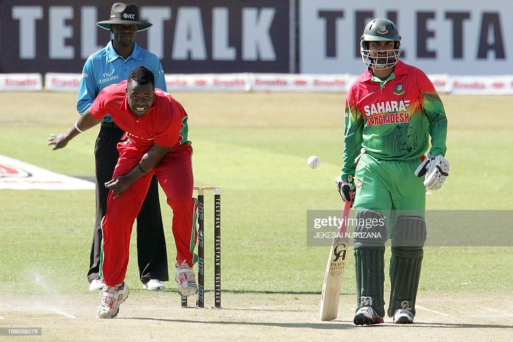 Zimbabwe's pace bowler Brian Vitori bowls as Bangladesh batsman Tamim Iqbal looks on during the second and final Twenty20 international cricket series between Zimbabwe and Bangladesh on May 12, 2013 at the Queens Sports Club in Bulawayo. AFP PHOTO / Jekesai Njikizana
