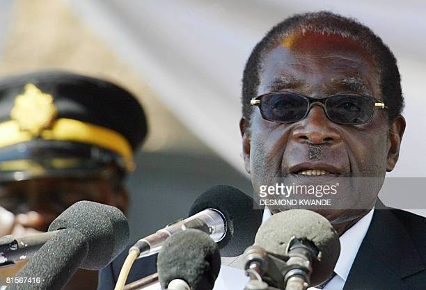 Zimbabwe's President Robert Mugabe addresses the crowd as he attends on June 14 2008 the burial ceremony for retired lieutenant general Amoth Norbert...