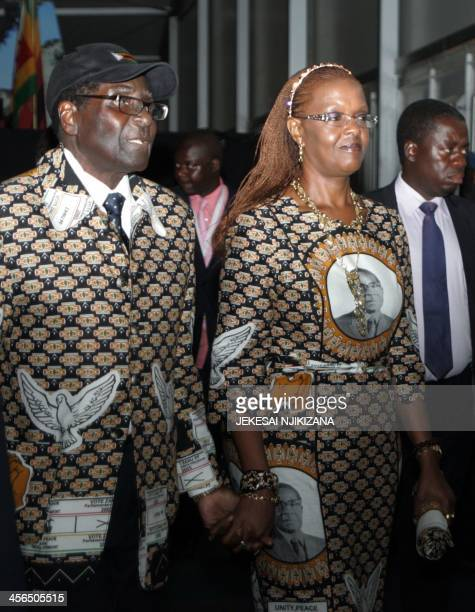Zimbabwe's president Robert Mugabe and his wife Grace Mugabe leave the conference venue during the opening day of Zimbabwe's ruling ZanuPF party...