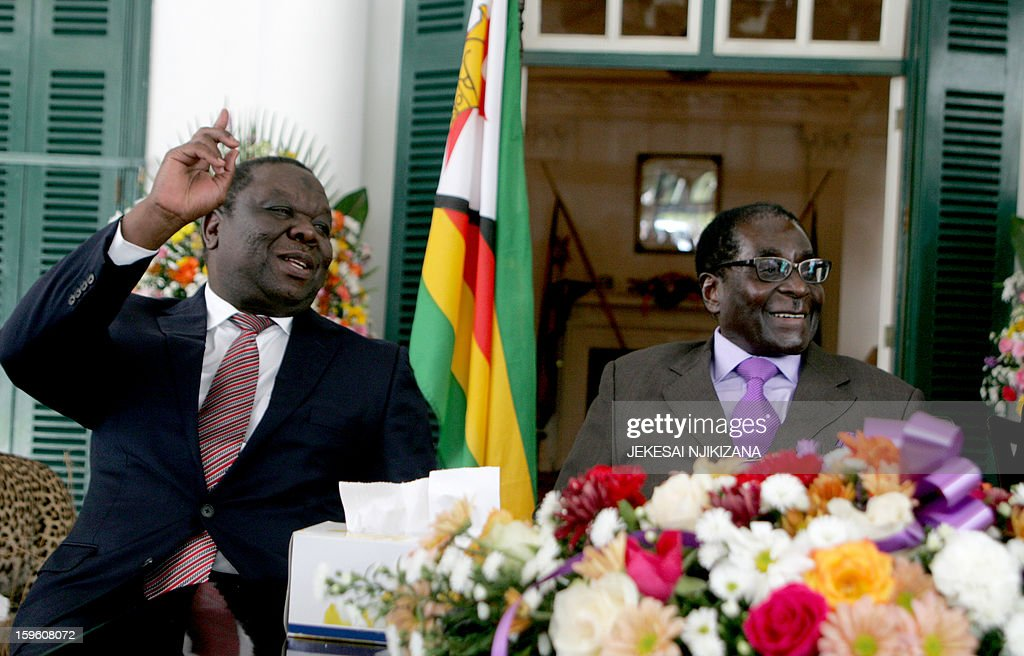 Zimbabwe's President Robert Mugabe (R) and Prime Minister Morgan Tsvangirai (L) announce the conclusion of the constitution making process at State House on January 17, 2013 in Harare. Mugabe said the country has concluded writing a draft constitution after all political parties agreed to the charter that is set to go for a referendum before elections this year. Mugabe and Tsvangirai formed a power-sharing government three years ago after violent and disputed polls in 2008. Their relations have been characterised by frequent bickering and counter-accusations of violence. A new draft constitution which is set to go for a referendum forms part of the key reforms to be made before fresh elections.
