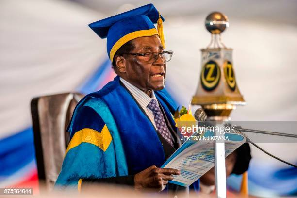 TOPSHOT Zimbabwe's President Robert Mugabe delivers a speech during a graduation ceremony at the Zimbabwe Open University in Harare where he presides...