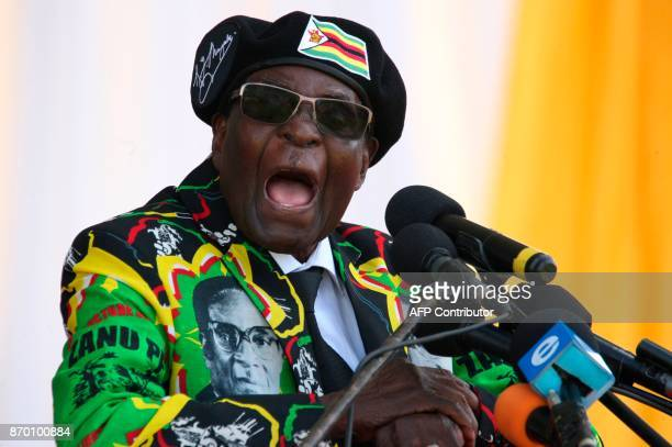 Zimbabwe's President Robert Mugabe delivers a speech during the Zimbabwe ruling party Zimbabwe African National Union Patriotic Front youth interface...