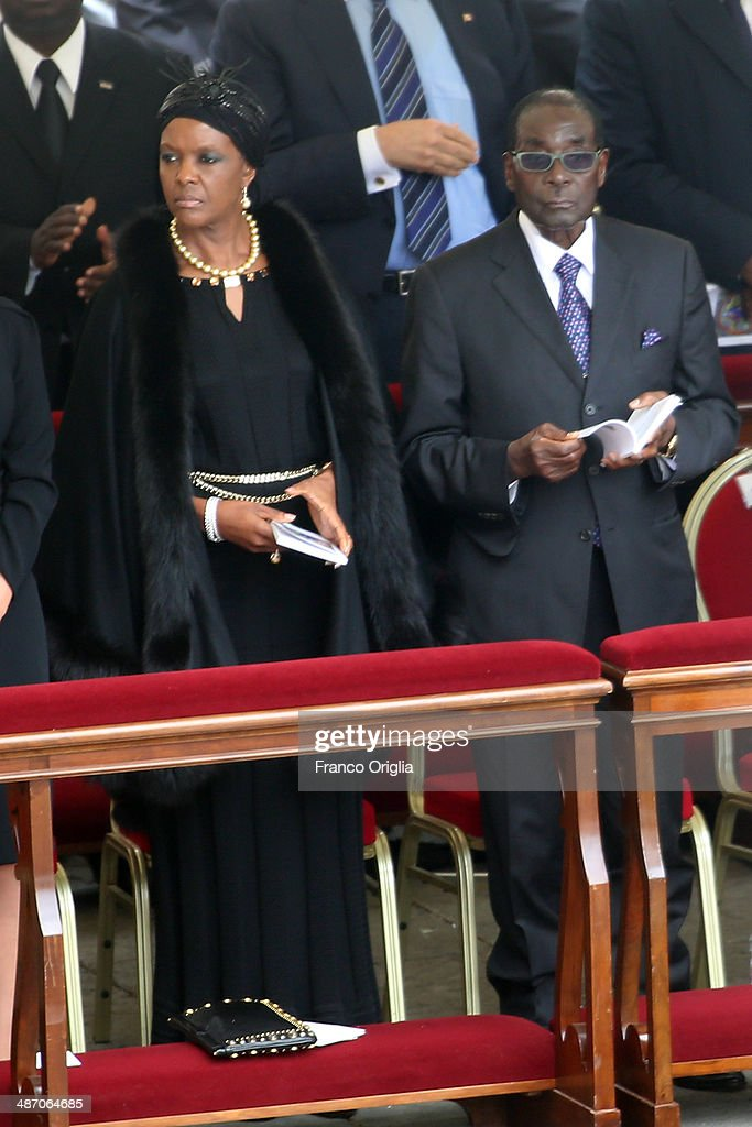 Zimbabwe's President <a gi-track='captionPersonalityLinkClicked' href=/galleries/search?phrase=Robert+Mugabe&family=editorial&specificpeople=214676 ng-click='$event.stopPropagation()'>Robert Mugabe</a> flanked by his wife Grace attend the canonisations of Popes John Paul II and John XXIII held by Pope Francis in Saint Peter's Square on April 27, 2014 in Vatican City, Vatican. Dignitaries, heads of state and Royals from Europe and across the World attended the canonisations.