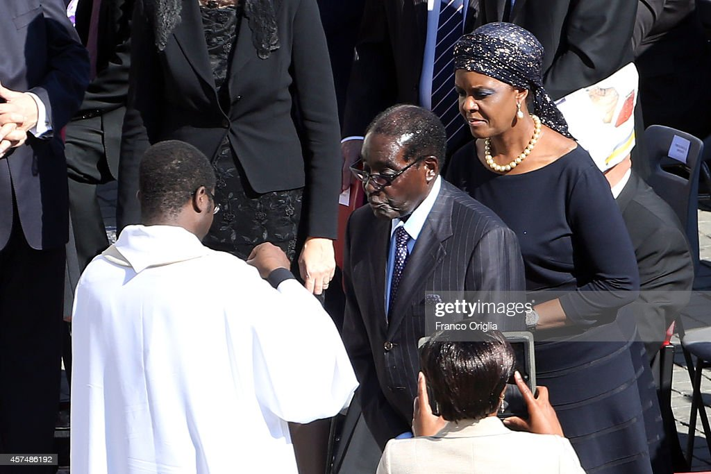 Zimbabwe's President <a gi-track='captionPersonalityLinkClicked' href=/galleries/search?phrase=Robert+Mugabe&family=editorial&specificpeople=214676 ng-click='$event.stopPropagation()'>Robert Mugabe</a> (C) flanked by his wife Grace (R) receive the communion during the holy mass for the closing of Extraordinary Synod held by Pope Francis at St. Peter's Square on October 19, 2014 in Vatican City, Vatican. During the Mass the Holy Father beatified his predecessor, Pope Paul VI, whom he described as a 'great Pope,' a 'courageous Christian' and a 'tireless apostle.