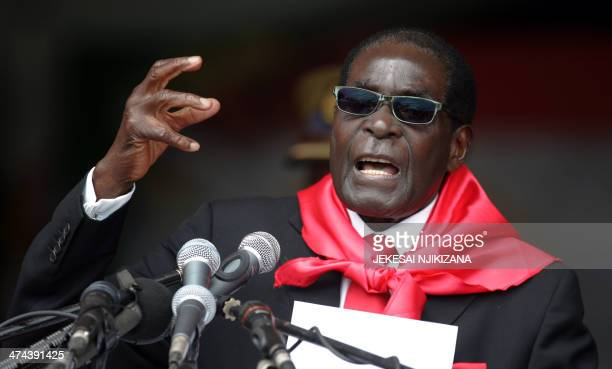 Zimbabwe's President Robert Mugabe talks during celebrations marking his 90th birthday in Marondera on February 23 2014 Thousands of people turned...