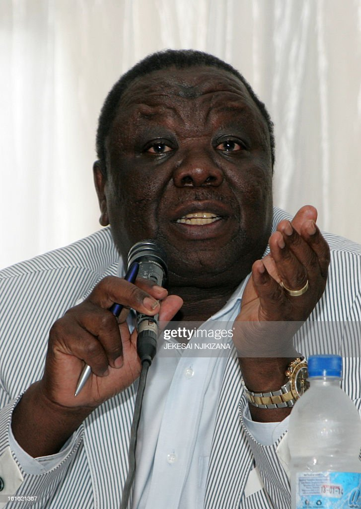 Zimbabwe's Prime Minister Morgan Tsvangirai addresses a meeting with representatives of civic groups in Harare on February 13, 2013 where he announced announced that the country will hold a constitutional referendum in March followed by elections in July, a timetable that will decide the fate of veteran President Robert Mugabe. Zimbabweans will be asked to vote on a basic law that would, for the first time, set presidential term limits and abolish the head of state's immunity. AFP PHOTO / Jekesai Njikizana.