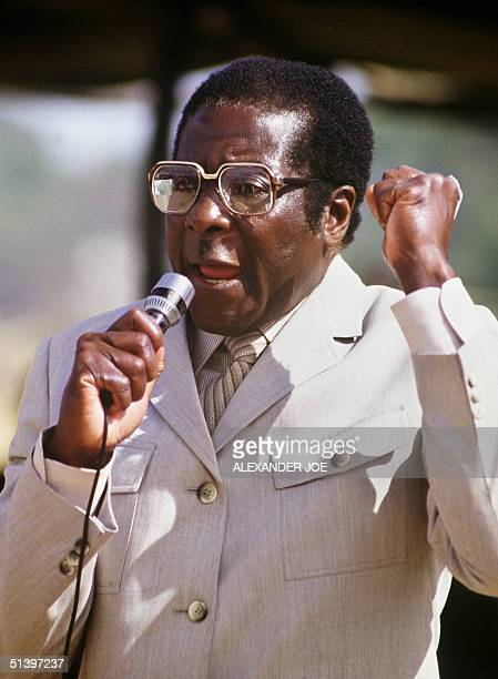Zimbabwe's Prime Minister Robert Mugabe addresses the crowd in July 1984 in Harare stadium during a meeting Mugabe Zimbabwean first Premier and...