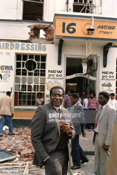 Zimbabwe's Prime Minister Robert Mugabe leaves 21 May 1986 the scene of the African National Congress offices that were bombed 19 May by a South...