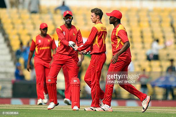 Zimbabwe's Sean Williams is congratulated by wicketkeeper Richmond Mutumbamiafter his dismissal of unseen Afghanistan batsman Mohammad Shahzad during...