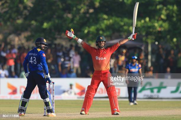 Zimbabwe's Sikandar Raza is seen in celebration mood after hitting winning runs as Sri Lanka's wicket keeper Niroshan Dickwella looks on plays a shot...