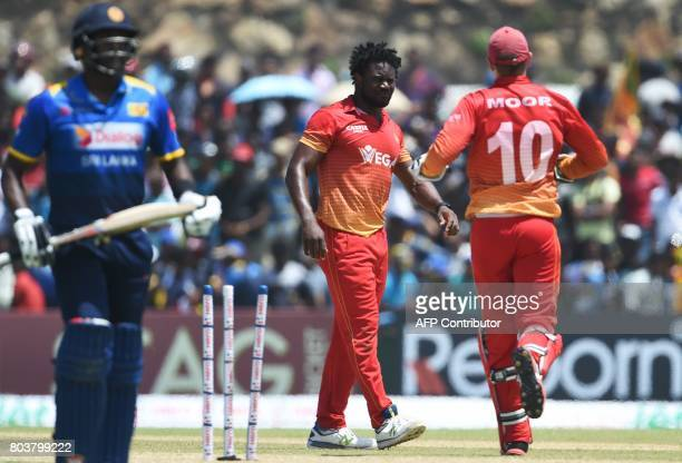 Zimbabwe's Solomon Mire reacts with his teammates after he dismissed Sri Lanka's captain Angelo Mathews during the first oneday international cricket...