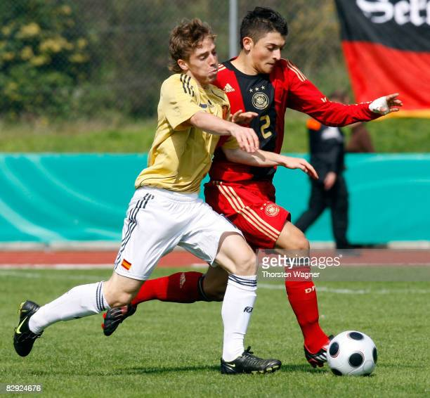 M Zimmermann of Germany battles for the ball with Iker Muniain of Spain during the U17 international friendly match between Germany and Spain at the...