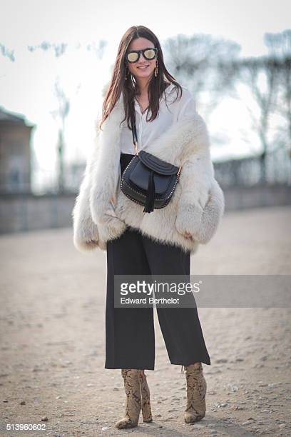 Zina Charkoplia is wearing a Chloe bag and Top Shop pants before the Elie Saab show during Paris Fashion Week Womenswear Fall Winter 2016/2017 on...