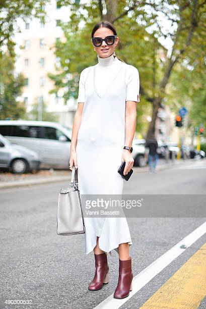 Zina Charkoplia poses wearing a CMEO Collective dress before the Marni show during the Milan Fashion Week Spring/Summer 16 on September 27 2015 in...