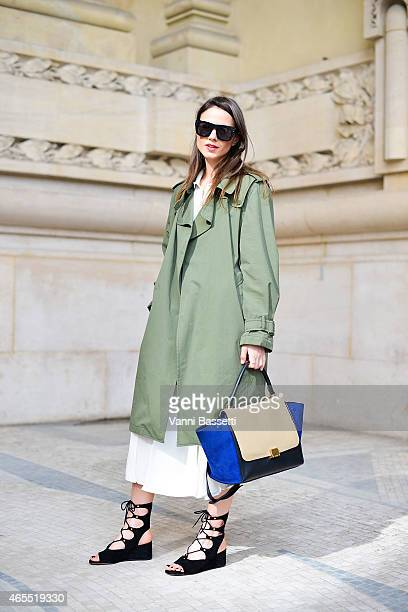Zina Charkoplia poses wearing a Zara jacket Reiss skirt Chloe shoes and Celine bag on Day 5 of Paris Fashion Week Womenswear FW15 on March 7 2015 in...