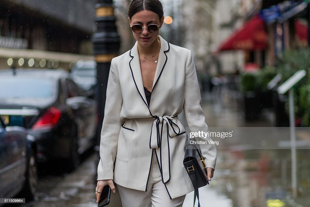 Zina Charkoplia wearing a creme suit and a black fur jacket and Yves Saint Laurent bag seen outside Julien Macdonald during London Fashion Week...
