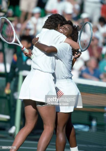 Zina Garrison and Pam Shriver of the USA embrace in celebration after defeating Jana Novotna and Helena Sukova of Czechoslovakia to win the Women's...