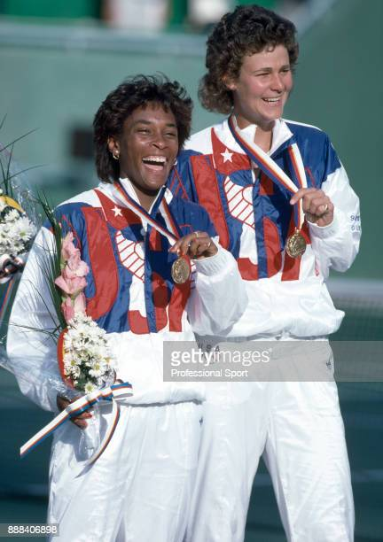 Zina Garrison and Pam Shriver of the USA pose with their gold medals after defeating Jana Novotna and Helena Sukova of Czechoslovakia to win the...