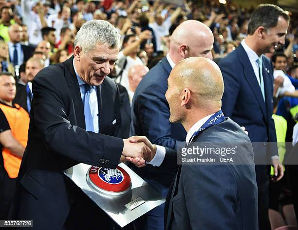 Zinédine Zidane head coach of Madrid is congratulated by Ángel María Villar Llona first vice president of UEFA after the UEFA Champions League Final...