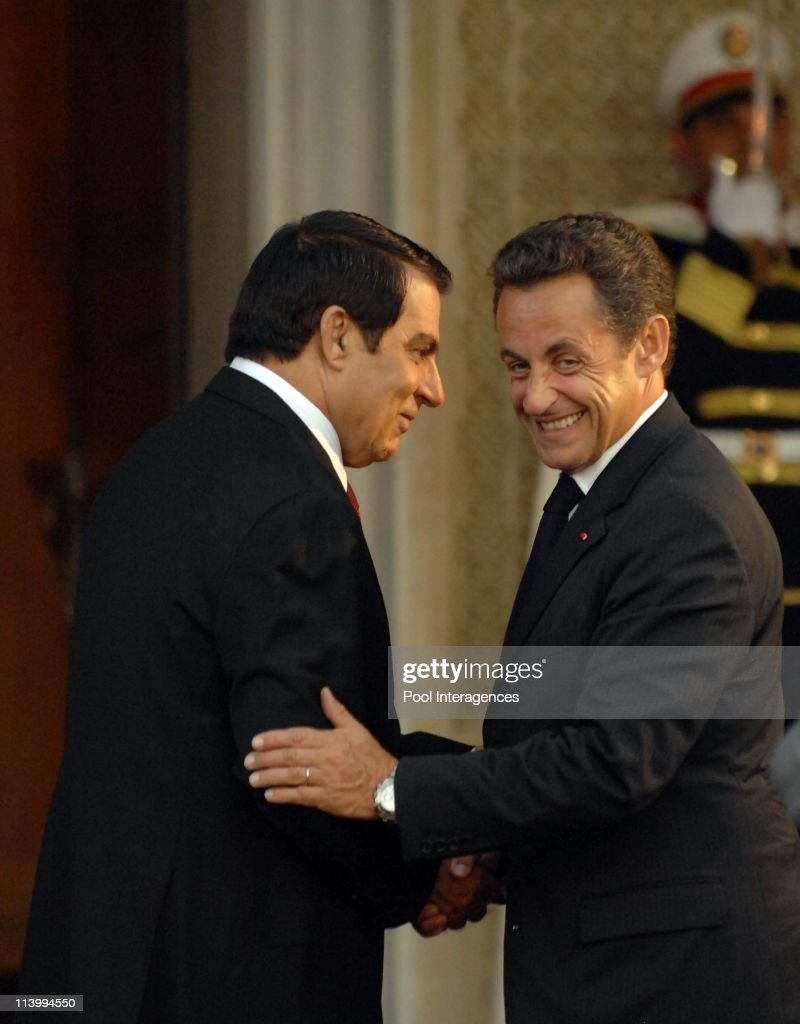 Zine el Abidine Ben Ali welcomes Nicolas Sarkozy In Tunis, Tunisia On July 10, 2007-Zine el Abidine Ben Ali and Nicolas Sarkozy. Tunisia President Zine el Abidine Ben Ali welcomes French President Nicolas Sarkozy at this airport.