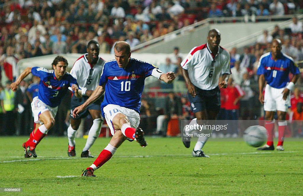 Zinedin Zidane of France scores their second goal from the penalty spot during the France v England Group B match in the 2004 UEFA European Football Championships at the Estadio da Luz on June 13, 2004 in Lisbon, Portugal.