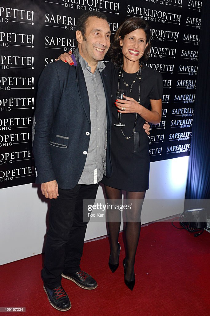 Zinedine Soualem and Saperlipopette owner Marie Laure Gaouaoui attend Saperlipopette' : Norbert Cremaillere Party on November 17, 2014 in Puteaux, France.