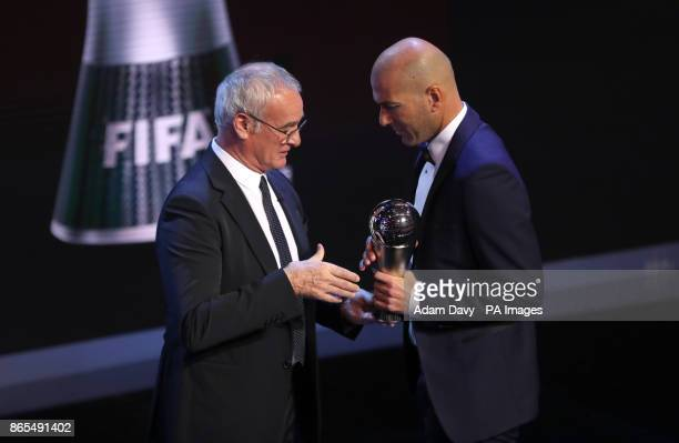 Zinedine Zidane accepts the award for FIFA Mens Coach of the Year from Claudio Ranieri during the Best FIFA Football Awards 2017 at the Palladium...