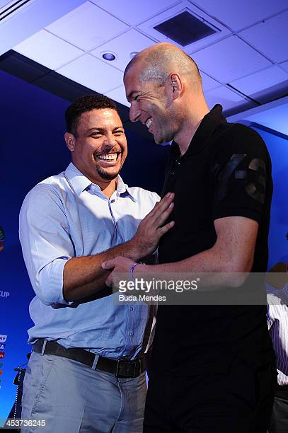 Zinedine Zidane greets Ronaldo on stage after the FIFA World Cup Ambassadors Press Conference during a media day ahead of the 2014 FIFA World Cup...
